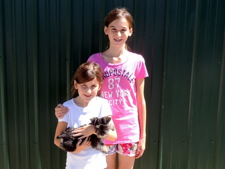 Abigail and Sarah from Ft. Meade, Md. are happy to be taking their new friend, Red ( a Miniature Schnauzer) home with them.